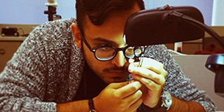 Nikhil Hathiramani Facets Second Generation inspecting a diamond